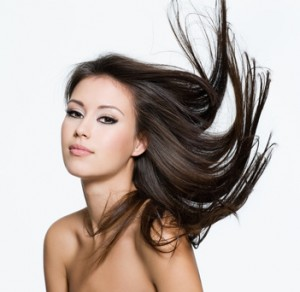 Sensual young woman with creative hairstyle